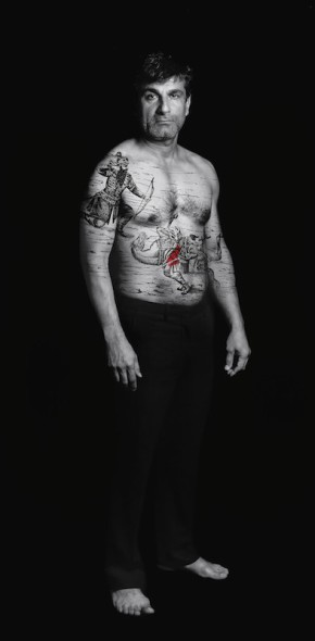 Shirin Neshat, Amir (Villains) from the series The Book of Kings, 2012, gelatin silver print with acrylic, 99 × 49 1/2 in., Los Angeles County Museum of Art, gift of Lynda and Stewart Resnick through the 2017 Collectors Committee, © Shirin Neshat, photo courtesy the artist and Gladstone Gallery, New York and Brussels
